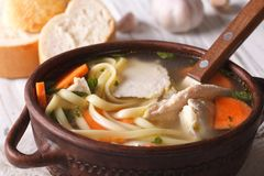Homemade chicken soup with noodles close-up. Horizontal Royalty Free Stock Photos