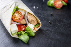 Homemade Chicken Wrap. (close-up shot) on vintage background (selective focus Stock Images