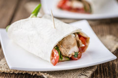 Homemade Chicken Wrap. (close-up shot) on vintage background (selective focus Stock Photo