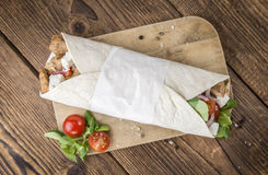 Homemade Chicken Wrap. (close-up shot) on vintage background (selective focus Stock Photography
