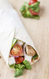 Homemade Chicken Wrap. (close-up shot) on vintage background (selective focus Royalty Free Stock Photo