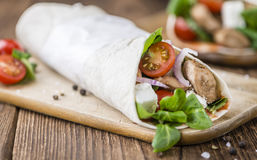 Homemade Chicken Wrap. (close-up shot) on vintage background (selective focus Royalty Free Stock Images