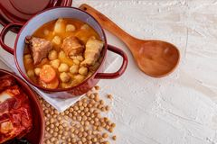Homemade chickpea stew Madrid stew of chickpeas, meat and vegetables. royalty free stock image