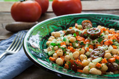 Homemade chickpeas salad. Chickpeas salad with cherry tomato and cucumber on plate Stock Photos