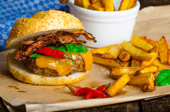Homemade chilli burger with home spicy fries Stock Image