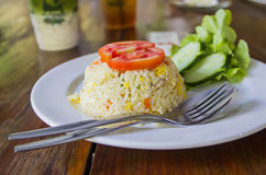 Homemade Chinese fried rice with vegetables, chicken and fried eggs served on a plate with chopsticks (Selective Focus, Focus one Royalty Free Stock Photo