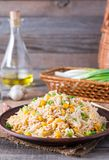 Homemade Chinese fried rice with vegetables and fried eggs on a plate Selective Focus stock images