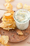 Homemade chips with dip. Homemade potato chips with a glass of mayonaise dip stock images