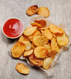 Homemade chips with tomato sauce. Potato chips Royalty Free Stock Image