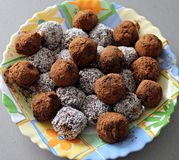 Homemade choclate truffles. Homemade chocolate truffles on a colorful plate stock image