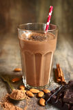 Homemade chocolate banana smoothie in a glass. Royalty Free Stock Image