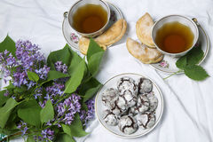 Homemade chocolate breakfast  cookies  and spring flowers. Homemade biscuit. Cup of Tea  with homemade chocolate breakfast  cookies  and spring flowers Royalty Free Stock Image