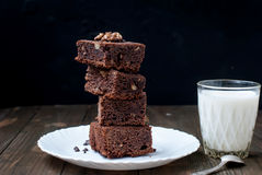 Homemade chocolate brownie cake and a glass of milk, low key Stock Photography