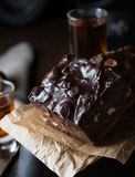 Homemade chocolate brownies with nuts and ganache Royalty Free Stock Photos