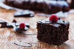 Homemade chocolate brownies. With raspberry on the wooden background Stock Photos