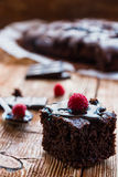 Homemade chocolate brownies. With raspberry on the wooden background Stock Photo