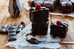 Homemade chocolate brownies. With raspberry on the wooden background Royalty Free Stock Photo