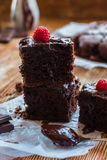 Homemade chocolate brownies. With raspberry on the wooden background Royalty Free Stock Photography