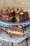 Chocolate cake with caramel and walnuts Stock Photos