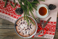 Homemade chocolate cake with cherries and fresh berries on the w Royalty Free Stock Photography