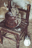 Homemade Chocolate Cake with Coconut Flakes and Dried Flower Decoration on a Small Vintage Chair Stock Image