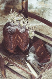 Homemade Chocolate Cake with Coconut Flakes and Dried Flower Decoration on a Small Vintage Chair Stock Photo