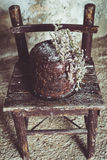 Homemade Chocolate Cake with Coconut Flakes and Dried Flower Decoration on a Small Vintage Chair Royalty Free Stock Image