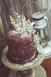 Homemade Chocolate Cake with Coconut Flakes and Dried Flower Decoration on a Small Vintage Wood Reel Stock Image