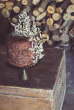 Homemade Chocolate Cake with Coconut Flakes and Dried Flower Decoration on a Vintage Chest Royalty Free Stock Photography