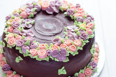 Homemade chocolate cake with colorful cream flowers Royalty Free Stock Images