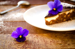 Homemade chocolate cake with cream cheese, walnuts and flowers Royalty Free Stock Photography