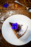 Homemade chocolate cake with cream cheese, walnuts and flowers Stock Image