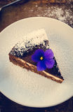 Homemade chocolate cake with cream cheese, walnuts and flowers Stock Images