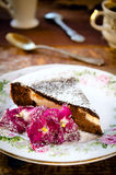 Homemade chocolate cake with cream cheese, walnuts and flowers Royalty Free Stock Image