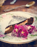 Homemade chocolate cake with cream cheese, walnuts and flowers Royalty Free Stock Images