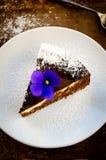 Homemade chocolate cake with cream cheese, walnuts and flowers Stock Photo