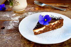 Homemade chocolate cake with cream cheese, walnuts and flowers Royalty Free Stock Photos