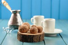 Homemade chocolate candies on wood slabs with cezve and coffee c Stock Photo