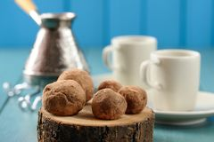 Homemade chocolate candies on wood slabs with cezve and coffee c Stock Image