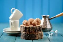 Homemade chocolate candies on wood slabs with cezve and coffee c Royalty Free Stock Photos