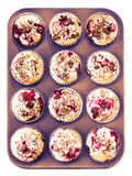Homemade chocolate and cherry muffins in paper cupcake holder in Royalty Free Stock Photo