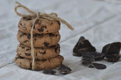 Chocolate chip cookies on rustic background. Closeup stock photography