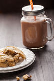 Homemade chocolate chip oatmeal cookies on dark wooden background Royalty Free Stock Photography