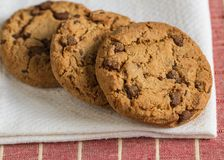 Chocolate chip cookies, close up. Homemade chocolate chips cookies on a napkin Royalty Free Stock Image