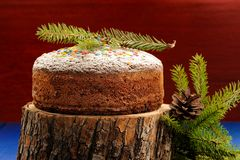 Homemade chocolate christmas fruit cake on wooden stand, fur bru Royalty Free Stock Photography