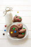 Homemade chocolate cookies decorated with colored candy drops and bottle of milk Royalty Free Stock Images