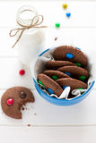 Homemade chocolate cookies decorated with colored candy drops and bottle of milk royalty free stock photo