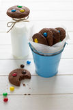 Homemade chocolate cookies decorated with colored candy drops and bottle of milk Royalty Free Stock Image