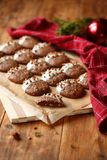 Homemade Chocolate Cookies. With Hazelnuts glazed in white chocolate, on a wooden table royalty free stock photography