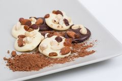 Homemade chocolate cookies with nuts and dried fruits in composition stock image